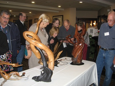 Members admire driftwood artwork at October luncheon